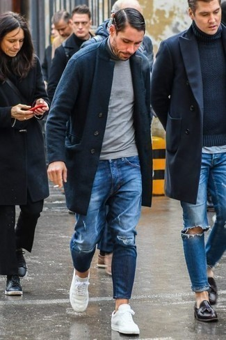 How to Wear Blue Ripped Jeans For Men: To don a casual outfit with a modernized spin, make a navy overcoat and blue ripped jeans your outfit choice. White canvas low top sneakers integrate nicely within a great deal of getups.