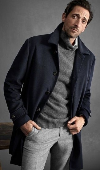 How to wear: navy overcoat, grey turtleneck, white long sleeve shirt, grey wool dress pants