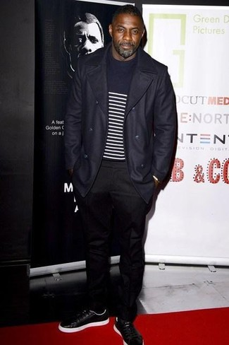 Idris Elba wearing Navy Overcoat, Navy and White Horizontal Striped Crew-neck Sweater, Black Chinos, Black Leather Low Top Sneakers