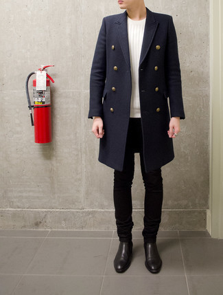 Navy Overcoat Outfits: A navy overcoat and black skinny jeans are essential in any guy's great off-duty wardrobe. Shake up your outfit with a dressier kind of shoes, such as these black leather chelsea boots.