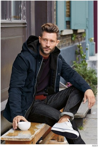 Make a parka and dark grey jeans your outfit choice for a comfy-casual look. Round off this look with white low top sneakers.