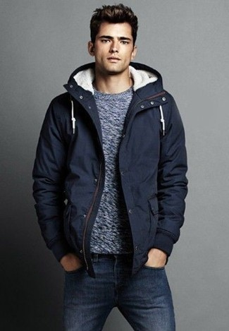 How to wear: navy parka, grey crew-neck sweater, navy jeans