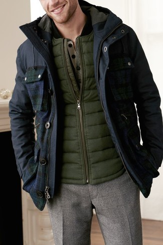 How to wear: navy parka, olive gilet, olive henley sweater, brown wool dress pants