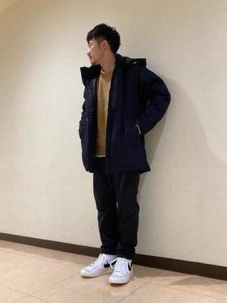 Navy Parka Outfits For Men: For something more on the off-duty end, you can go for a navy parka and black chinos. Add a pair of white and black leather high top sneakers to the mix to inject a touch of stylish nonchalance into your getup.