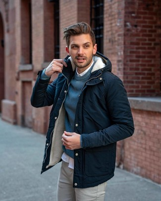 How to wear: navy parka, teal crew-neck sweater, white long sleeve shirt, grey chinos