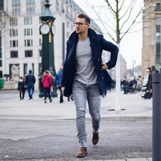 How to wear: navy pea coat, grey crew-neck t-shirt, grey ripped skinny jeans, brown suede chelsea boots