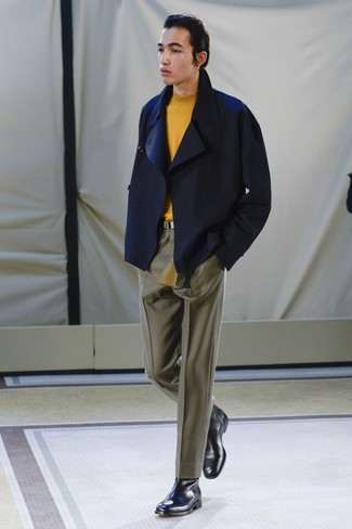 How to wear: navy pea coat, orange turtleneck, olive dress pants, black leather chelsea boots