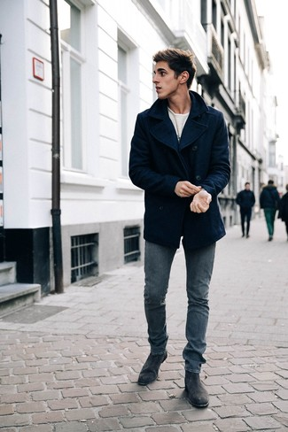 How to wear: navy pea coat, white print long sleeve t-shirt, navy skinny jeans, black suede chelsea boots