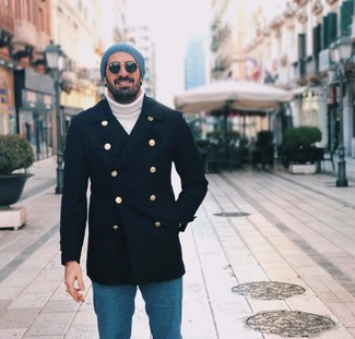 How to wear: navy pea coat, white knit turtleneck, blue jeans, blue beanie