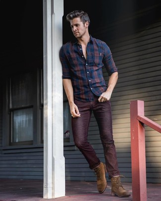 If you don't like getting too predictable with your outfits, wear a navy plaid long sleeve shirt and burgundy jeans. A pair of brown suede casual boots will add more polish to your overall look. Nothing like a cool combination to spice up a dreary autumn afternoon.