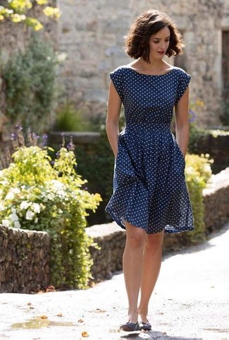 Dress in a navy blue polka dot fit and flare dress to steal the show. Mix things up by wearing ballerina flats.