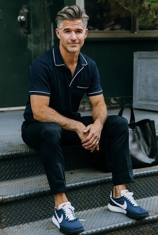 How to Wear a Polo For Men: A polo and black chinos are a combo that every sharp gent should have in his off-duty collection. Go ahead and add a pair of navy athletic shoes to the equation for a fun vibe.