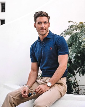 How to wear: navy polo, khaki chinos, black sunglasses, brown leather watch