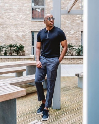 Polo Outfits For Men: Marry a polo with navy vertical striped chinos if you wish to look casually stylish without too much work. When in doubt about what to wear on the shoe front, stick to navy leather low top sneakers.