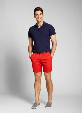Busy days call for a simple yet stylish outfit, such as a navy polo and red shorts. Round off this look with slip-on sneakers.