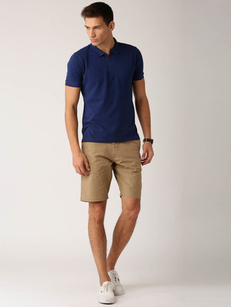 How to Wear White Plimsolls For Men: Why not make a navy polo and tan shorts your outfit choice? These pieces are totally comfortable and will look awesome worn together. A pair of white plimsolls acts as the glue that ties your getup together.