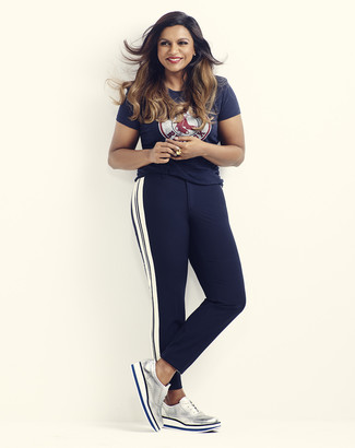How to wear: navy print crew-neck t-shirt, navy vertical striped skinny pants, silver leather brogues