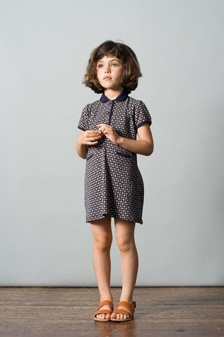 How to Wear Navy Dress For Girls: Suggest that your child dress in navy dress for an easy to wear, everyday look. This look is complemented brilliantly with tan sandals.