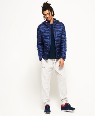 How to wear: navy puffer jacket, black crew-neck sweater, white sweatpants, red and black athletic shoes