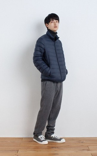 Navy Lightweight Puffer Jacket Outfits For Men: This combo of a navy lightweight puffer jacket and grey chinos is the ideal balance between dressy and casual. Introduce a pair of grey canvas low top sneakers to the mix to have some fun with things.
