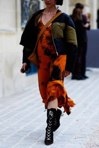 How to wear: navy puffer jacket, orange tie-dye maxi dress, black suede lace-up ankle boots, tan leather crossbody bag