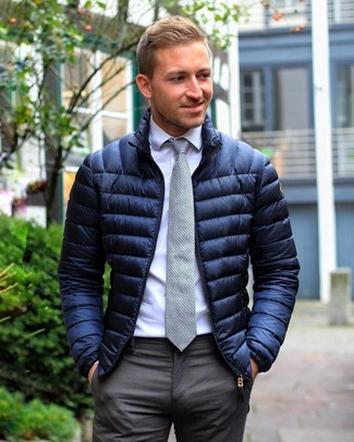 How to wear: navy puffer jacket, white dress shirt, charcoal dress pants, grey polka dot tie