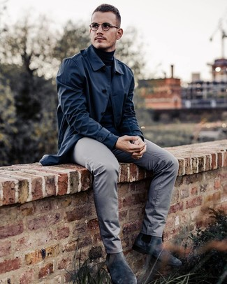 How to wear: navy raincoat, black turtleneck, grey chinos, charcoal suede chelsea boots