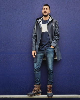 How to wear: navy raincoat, navy and white crew-neck sweater, navy jeans, brown snow boots