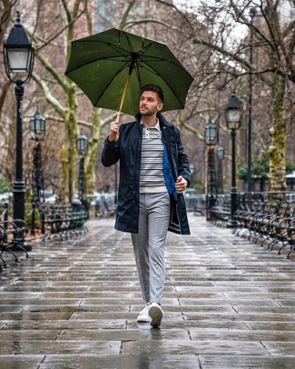 How to wear: navy raincoat, white and navy horizontal striped polo neck sweater, grey check chinos, white low top sneakers