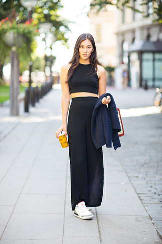 A black cropped top and a black maxi skirt are perfect for both running errands and a night out. White low top sneakers will add some edge to an otherwise classic look.