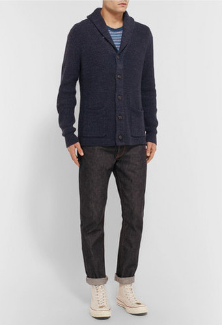 Stylish yet comfy, this look features a Polo Ralph Lauren men's Carded Cotton Shawl Cardigan and black jeans. To break out of the mold a little, throw in a pair of beige canvas high top sneakers. This ensemble is our idea of perfection for when temps are starting to drop and fall is in full swing.