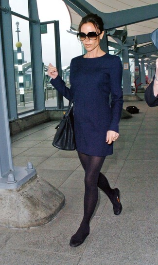 Glam up for the day in a navy blue wool shift dress. A pair of black leather ballerina flats will be a stylish addition to your outfit. You can bet this combination is the answer to all of your fall wear struggles.