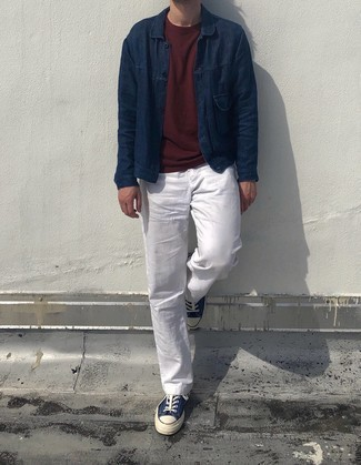Burgundy Crew-neck T-shirt Outfits For Men: A burgundy crew-neck t-shirt and white chinos are the kind of a foolproof casual combination that you need when you have no extra time. Introduce a pair of navy and white canvas low top sneakers to this look and the whole getup will come together really well.