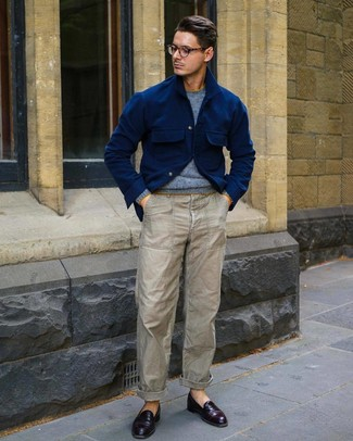 How to wear: navy wool shirt jacket, light blue crew-neck sweater, grey chinos, burgundy leather loafers