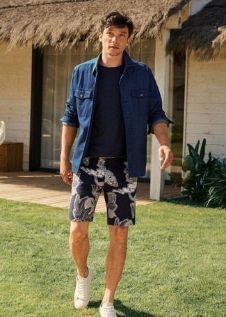How to Wear a Navy Denim Shirt Jacket For Men: This combo of a navy denim shirt jacket and navy floral shorts is definitive proof that a simple off-duty ensemble can still be seriously stylish. Kick up the wow factor of your getup by finishing with a pair of white canvas low top sneakers.