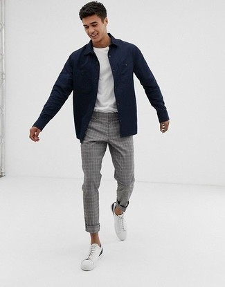 How to Wear Grey Plaid Chinos: This relaxed casual pairing of a navy shirt jacket and grey plaid chinos is extremely easy to pull together in no time flat, helping you look seriously stylish and ready for anything without spending a ton of time combing through your wardrobe. If you wish to easily dial down this outfit with footwear, why not complement this ensemble with white leather low top sneakers?