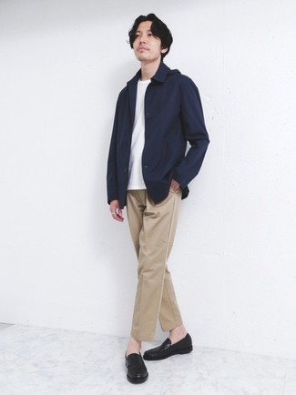 Jacket Outfits For Men: For a casually sleek ensemble, make a jacket and khaki chinos your outfit choice — these two pieces fit really well together. A pair of black leather loafers will bring a sleeker twist to your getup.