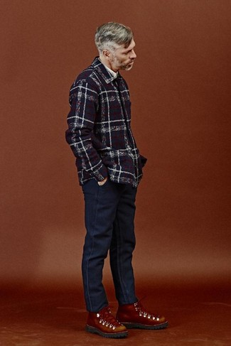 How to wear: navy plaid shirt jacket, white long sleeve shirt, navy jeans, tobacco leather work boots