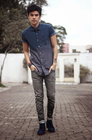 How to wear: navy chambray short sleeve shirt, grey jeans, navy suede desert boots, dark brown bracelet