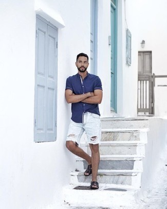 Light Blue Ripped Denim Shorts Outfits For Men: A huge thumbs up to this city casual combination of a navy short sleeve shirt and light blue ripped denim shorts! Black leather sandals are the simplest way to infuse a sense of stylish casualness into your look.