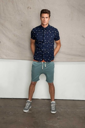 A dark blue print short sleeve shirt and shorts feel perfectly suited for weekend activities of all kinds. Grey high top sneakers will give your look an on-trend feel.