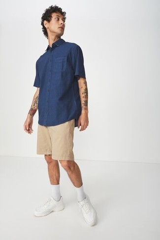 How to wear: navy short sleeve shirt, tan shorts, white leather low top sneakers, white socks
