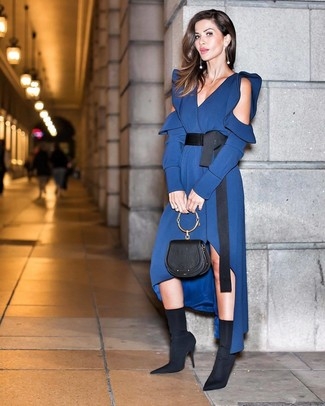 How to Wear Black Elastic Ankle Boots: Choose a navy silk midi dress to achieve an interesting and current casual ensemble. When it comes to shoes, this look pairs nicely with black elastic ankle boots.