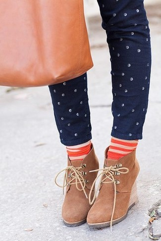 How to wear: navy polka dot skinny jeans, tan suede wedge ankle boots, tobacco leather tote bag, orange horizontal striped socks