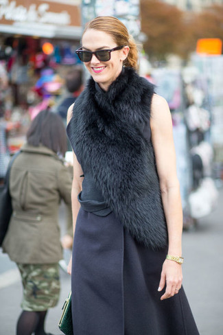 Effortlessly blurring the line between chic and casual, this pairing of a navy sleeveless coat and a Burberry women's Fur Stole is likely to become one of your favorites. And when you have one of those bleak fall days, sometimes only a kick-ass getup like this one can spice it up.