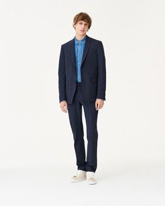 How to wear: navy suit, blue denim shirt, beige suede low top sneakers