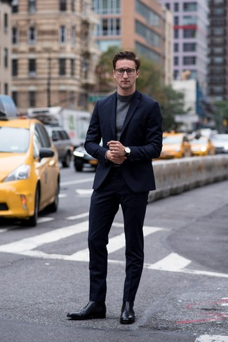 How to wear: navy suit, charcoal turtleneck, black leather chelsea boots, black leather watch