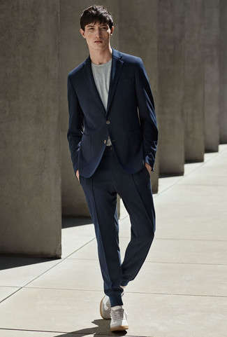 How to wear: navy suit, grey crew-neck t-shirt, grey suede low top sneakers