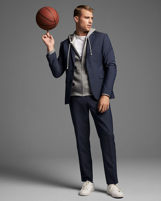 How to wear: navy suit, grey hoodie, white crew-neck t-shirt, white leather low top sneakers