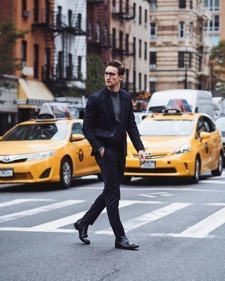 How to Wear a Grey Turtleneck For Men: Combining a grey turtleneck and a navy suit is a fail-safe way to breathe masculine sophistication into your day-to-day rotation. A pair of black leather chelsea boots is a goofproof footwear style that's full of character.